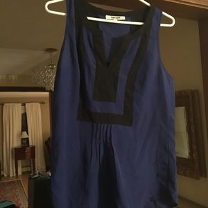 Sleeveless blue and black top